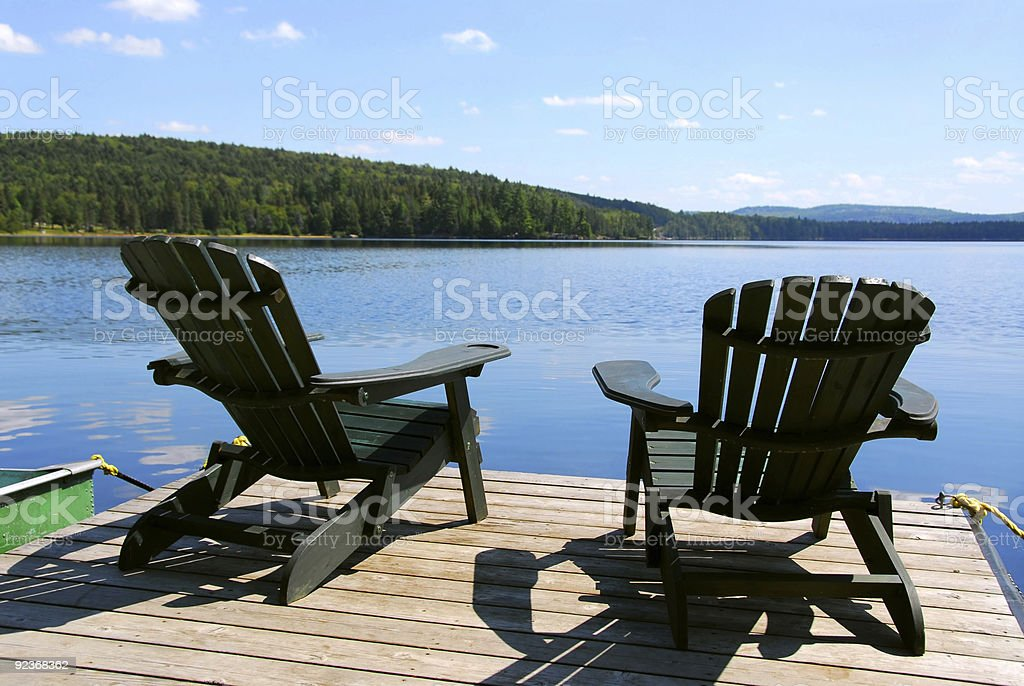 Chairs on dock stock photo