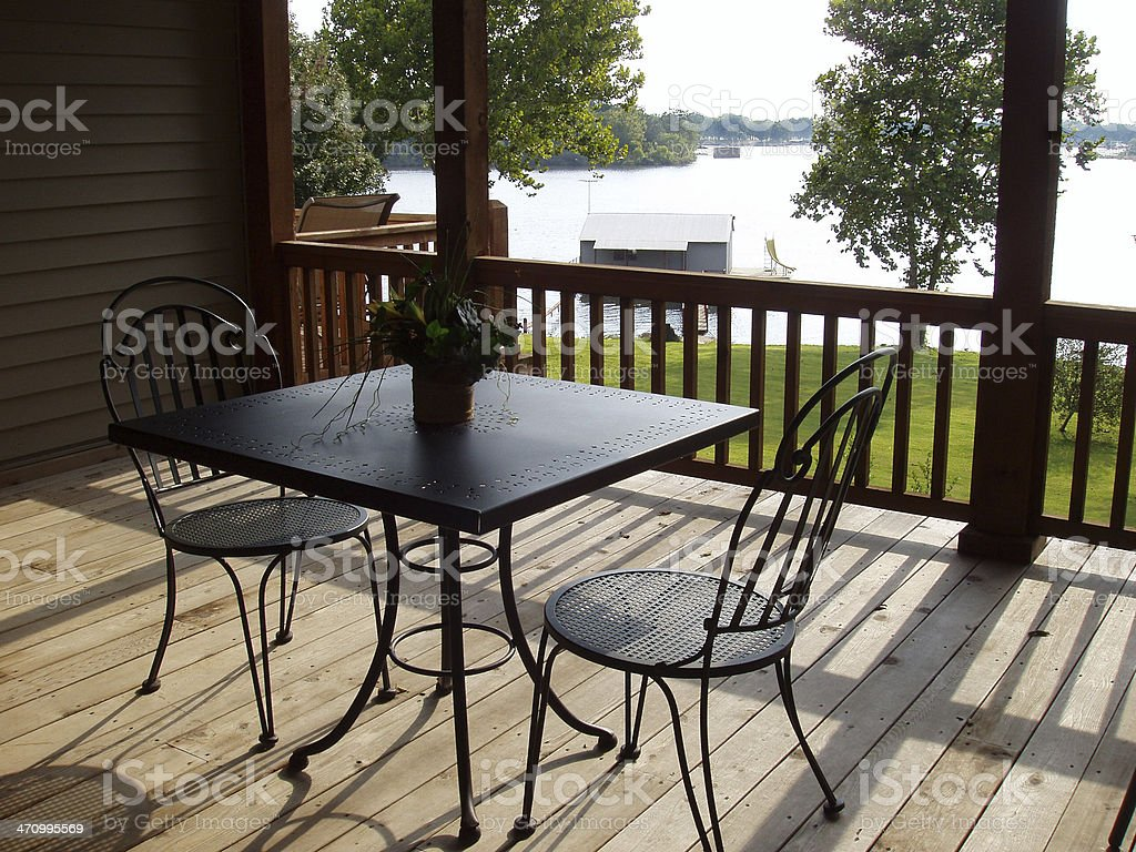 Chairs on Patio and Lake - Real Estate stock photo