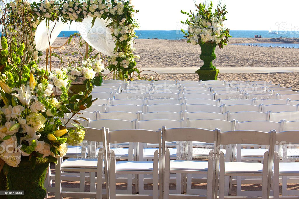 Chairs on the beach for a wedding ceremony royalty-free stock photo