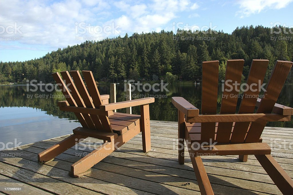 Chairs on the lake stock photo