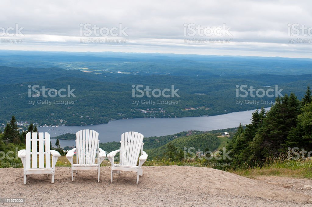 Chairs on top of mountain  at a ski resort stock photo