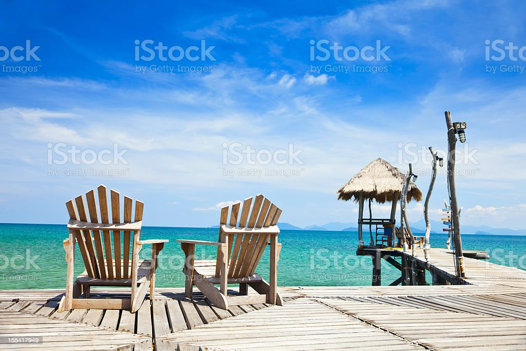 chairs on tropical coast royalty-free stock photo