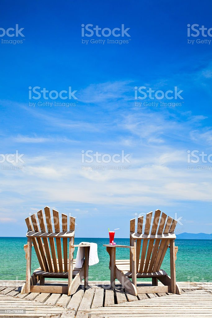 chairs on tropical coast stock photo