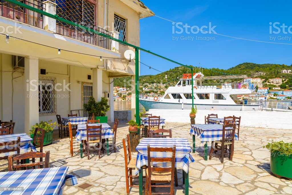 Chairs with tables in traditional Greek restaurant in Vathy port, Ithaca island, Greece stock photo