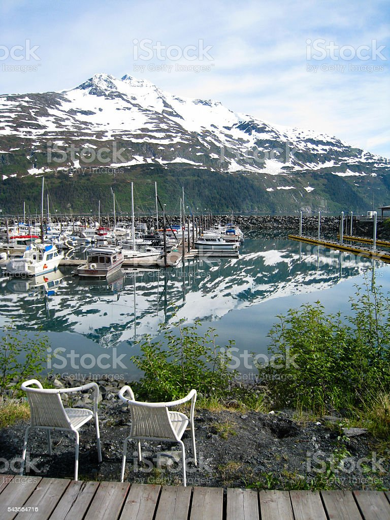 Chairs with the view of Whittier harbor in Alaska stock photo