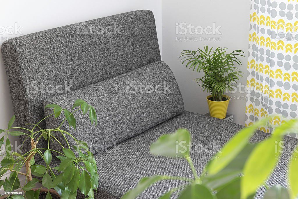 Chaise longue and plants in the living room royalty-free stock photo
