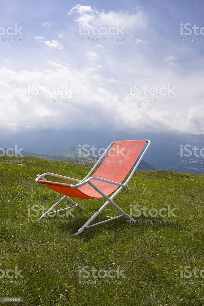 Chaise longue with a beautiful alpine scenic royalty-free stock photo