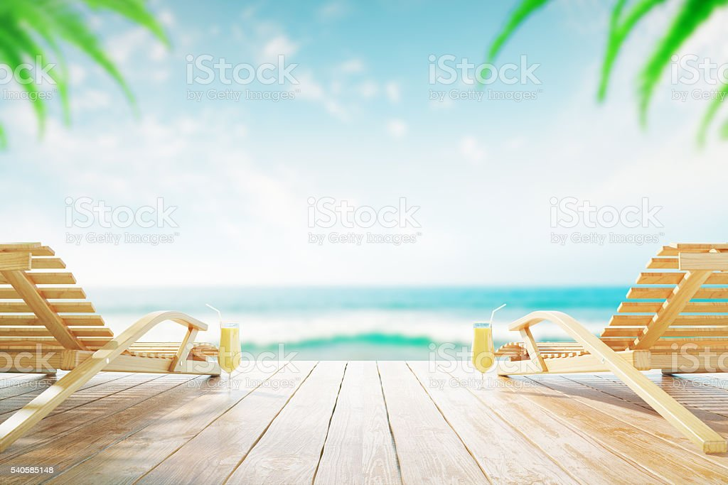 Chaise longues with cocktails stock photo