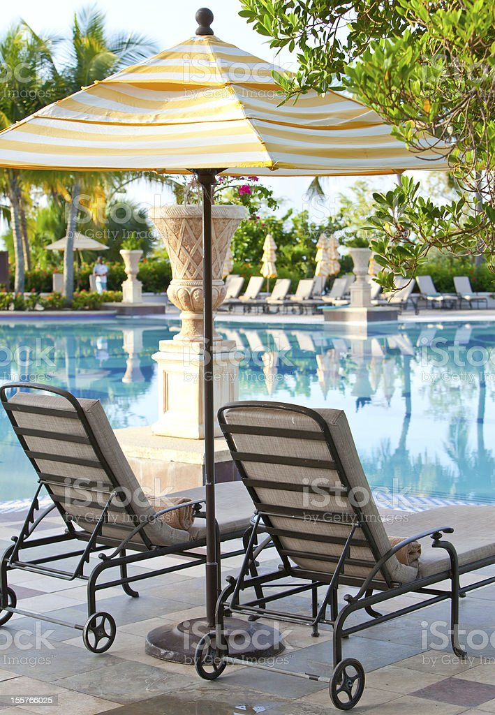 chaise lounges near pool royalty-free stock photo