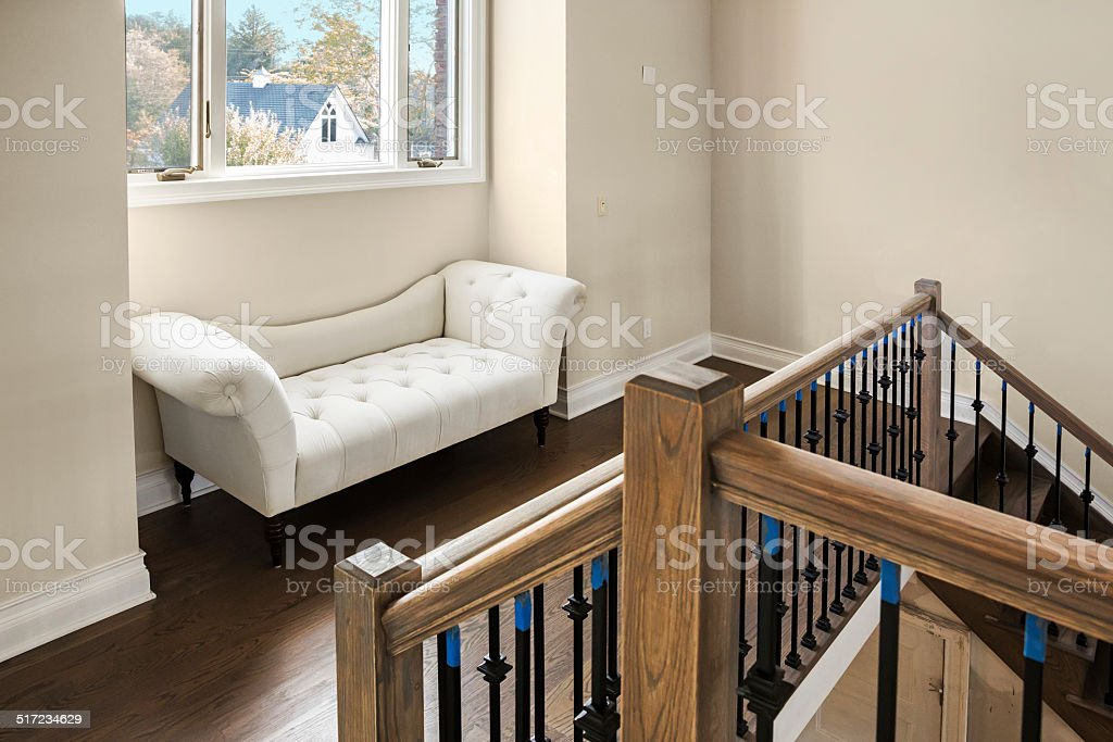 Chaise under a window in new home stock photo