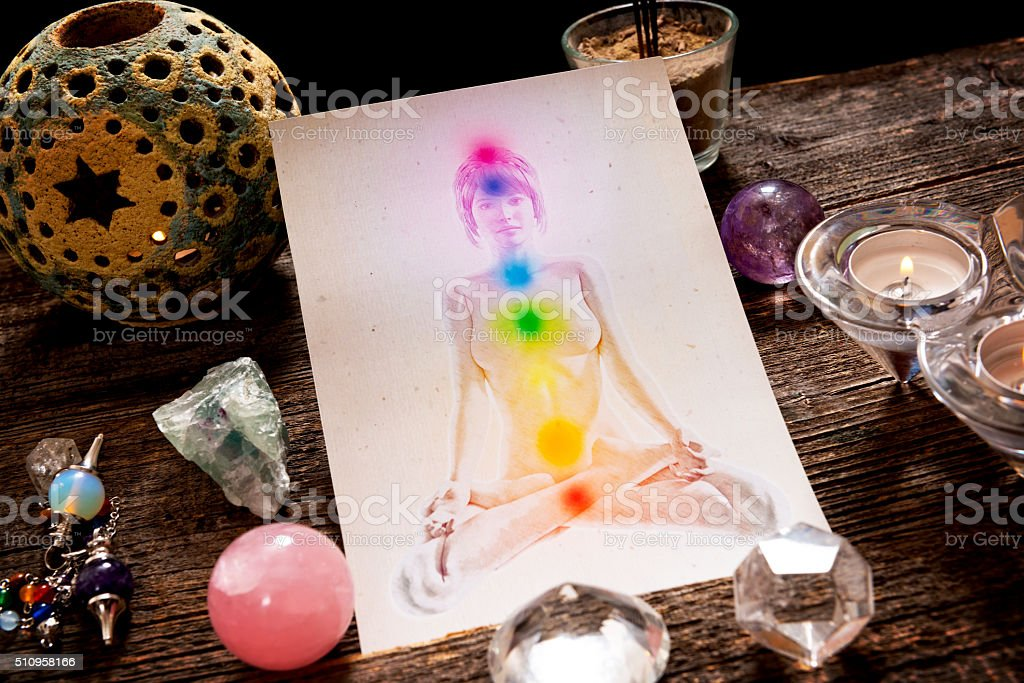 Chakras over a human body stock photo