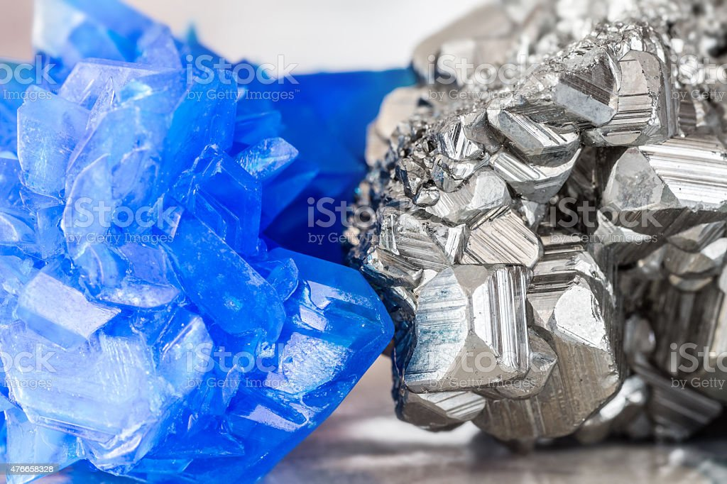 Chalcanthite blue copper sulfate and Auriferous Pyrite stone crystals stock photo