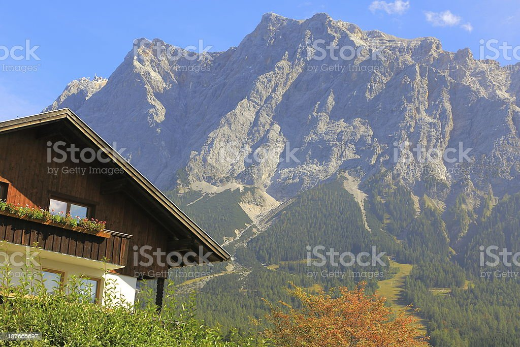 Chalet and Zugspitze stock photo
