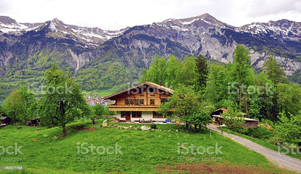 Chalet in swiss Alps stock photo