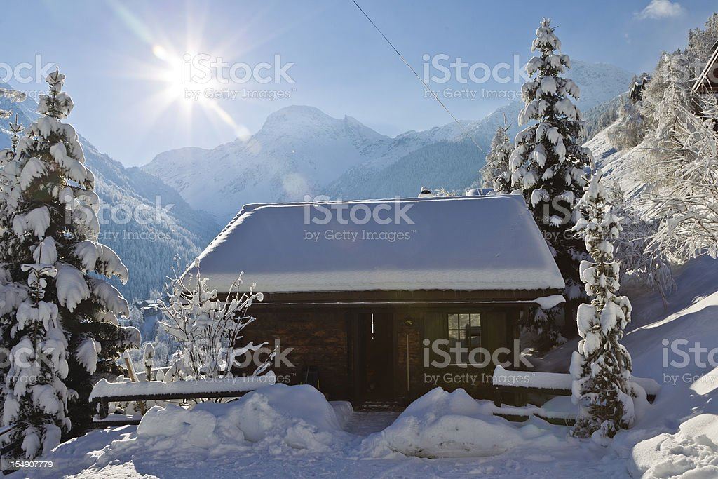 Chalet in the Swiss Alps mountains stock photo
