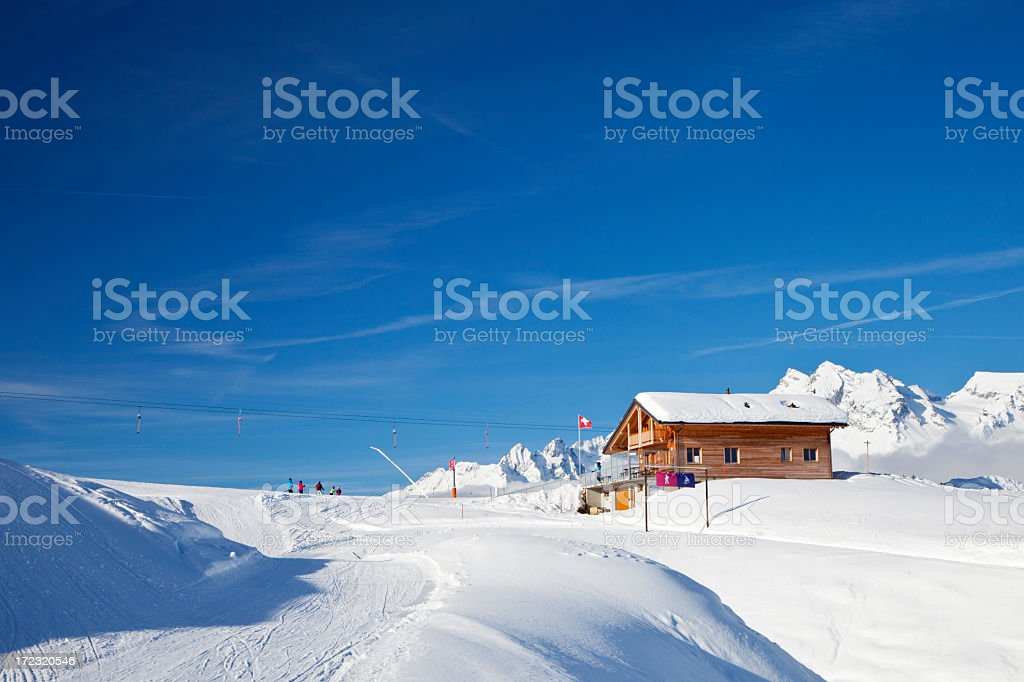Chalet on Ski Piste stock photo