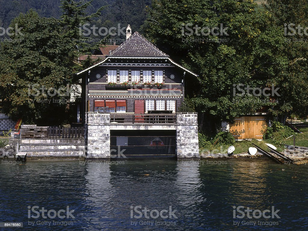 Chalet with boathouse on Lake Thun in Switzerland royalty-free stock photo