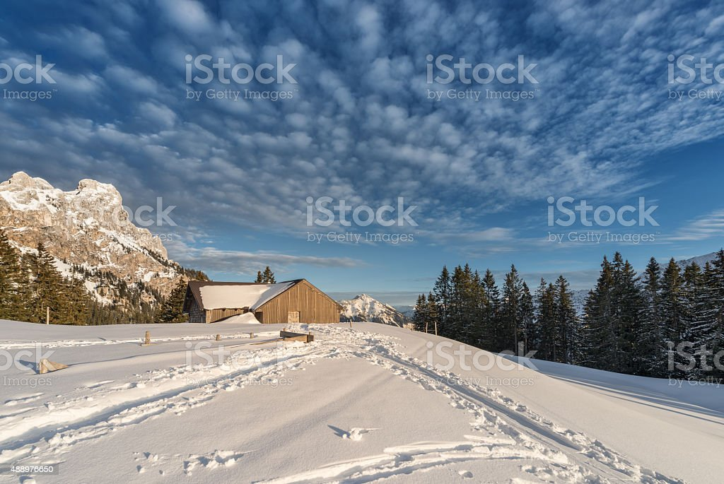 chalet with snow on austrian mountain at sunny winter day stock photo