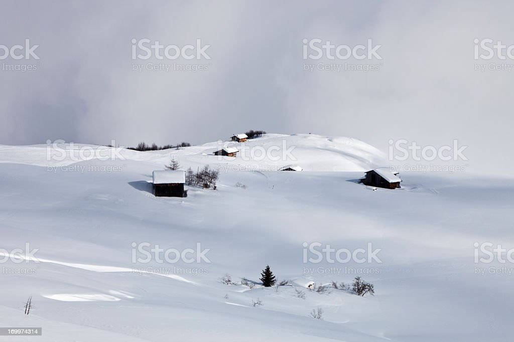 Chalets and Barns on Alp in Winter royalty-free stock photo