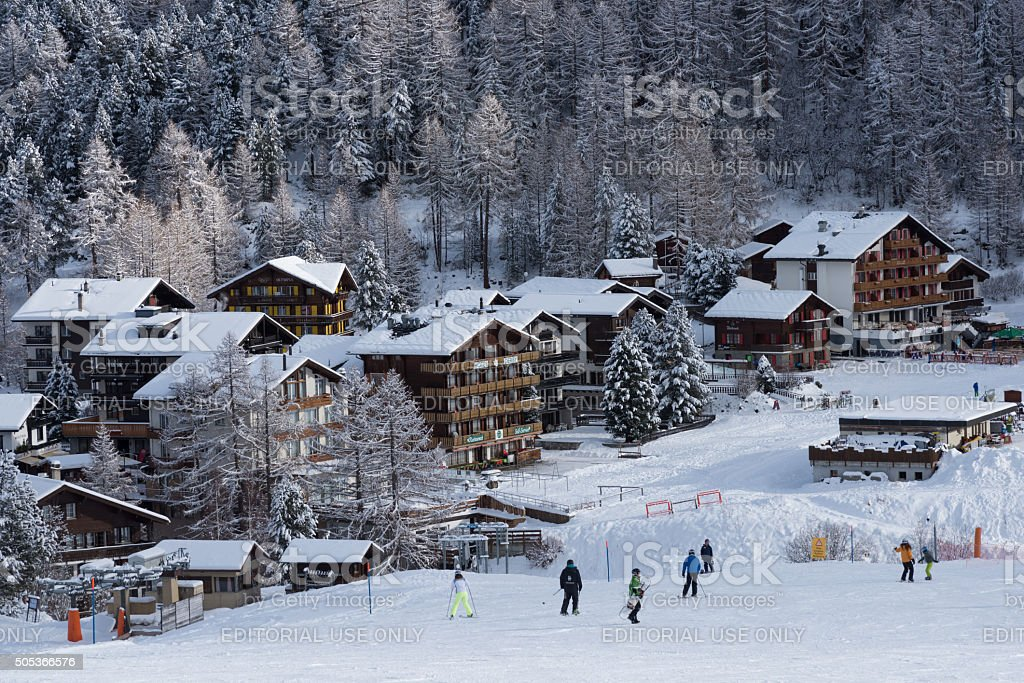 Chalets facing the ski slopes in Saas-Fee stock photo