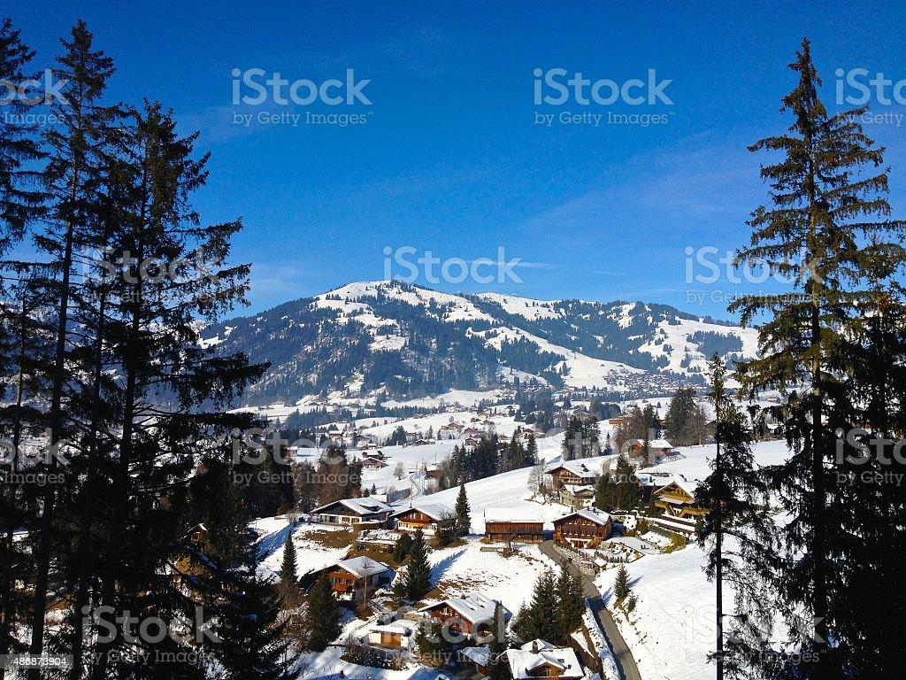 Chalets in snowy valley Gstaad Switzerland in winter stock photo
