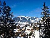 Chalets in snowy valley Gstaad Switzerland in winter