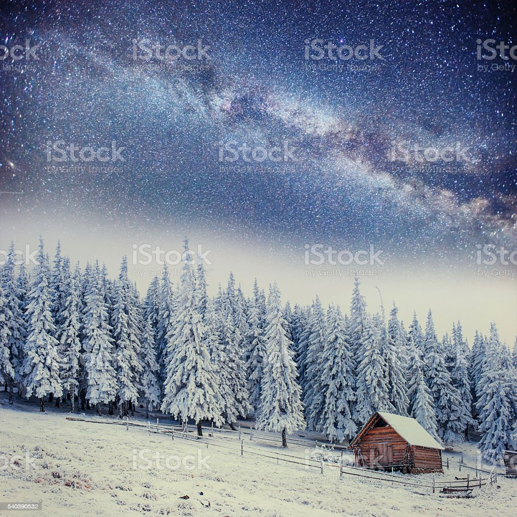 chalets in the mountains at night under the stars stock photo