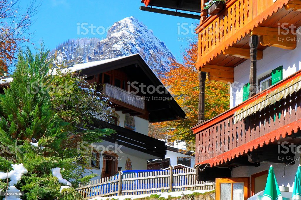 Chalets rustic balconies and Bavarian Alps, idyllic landscape, majestic alps valley, dramatic Bavaria german Snowcapped mountain range panorama, Berchtesgaden alps, Germany stock photo