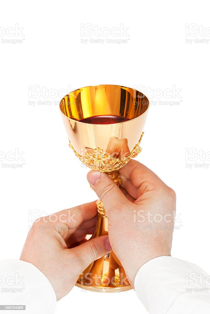 Chalice and  priest hands stock photo
