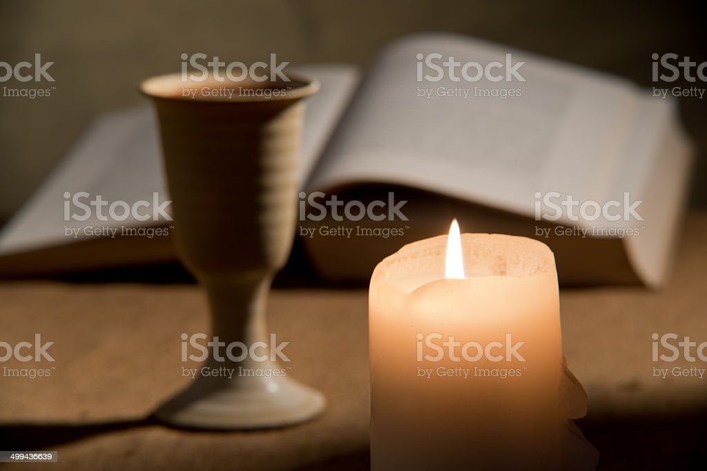 chalice of wine and bible stock photo