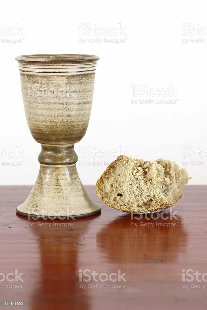 Chalice with wine and bread stock photo