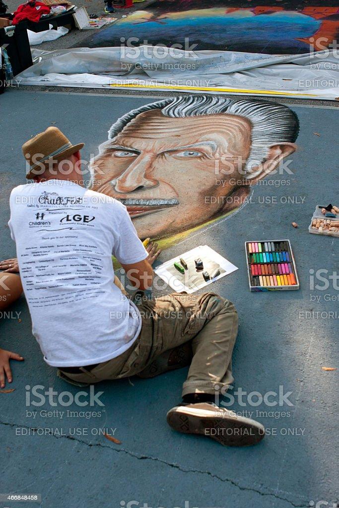 Chalk Artist Draws Vincent Price On Street For Halloween stock photo