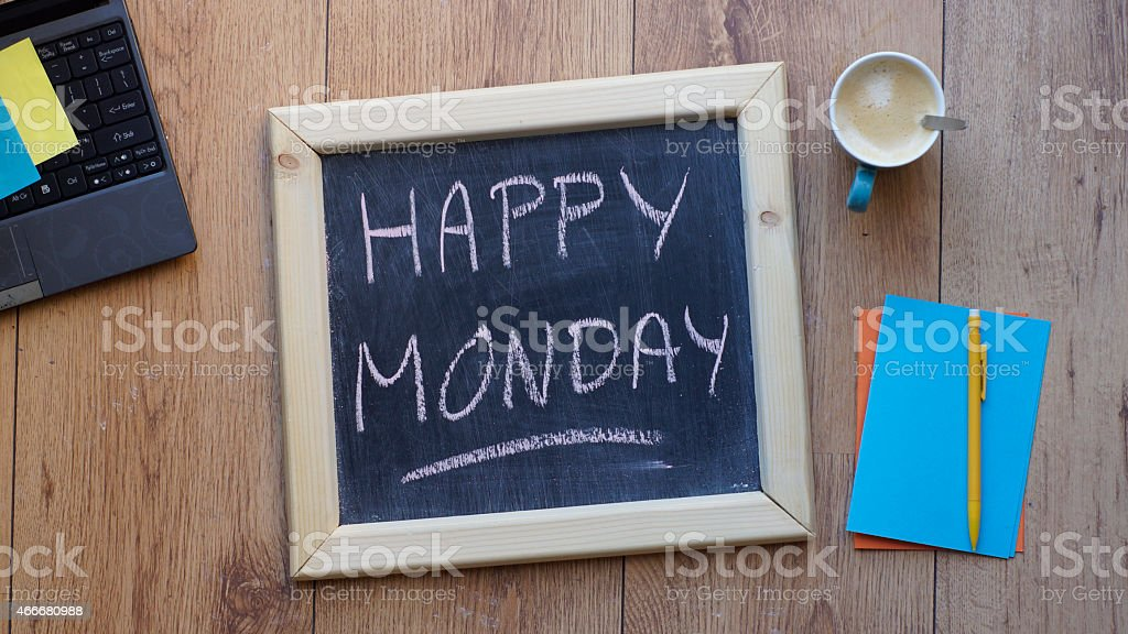 A chalk board with happy Monday wrote on it stock photo