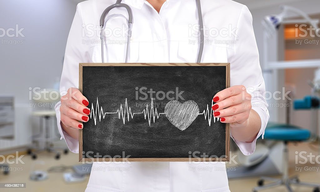 chalk board with heart pulse stock photo