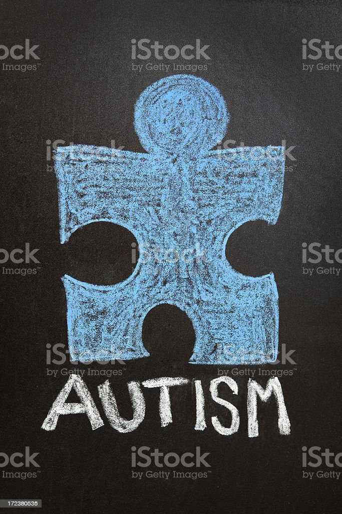 Chalk Drawing of Blue Puzzle Piece and Autism royalty-free stock photo