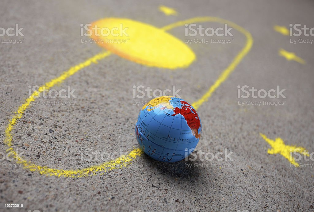 Chalk drawing of sun and a globe royalty-free stock photo