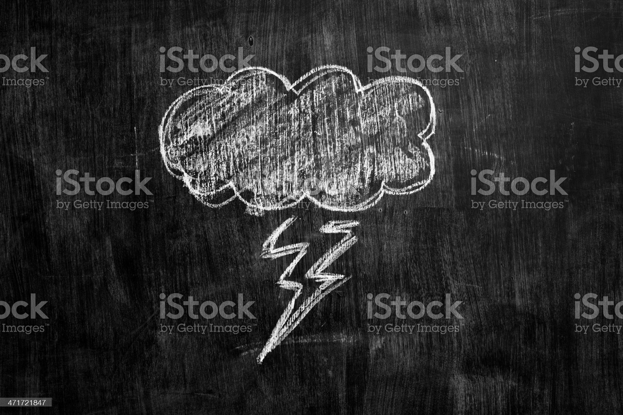 Chalk drawing of thundercloud on blackboard royalty-free stock photo
