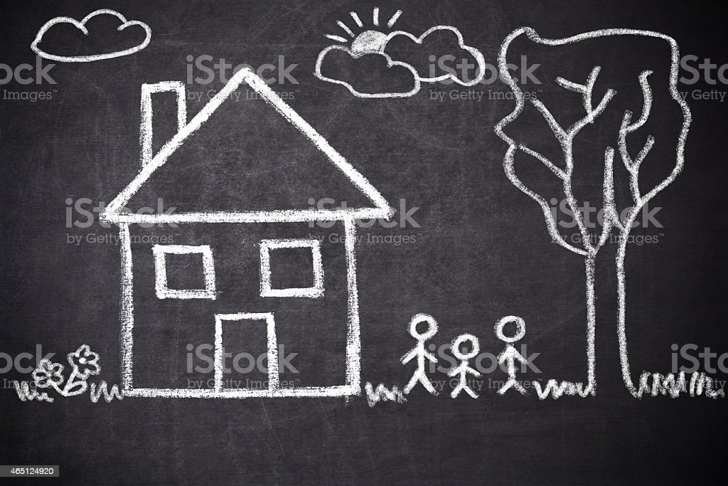 Chalk drawing on a chalkboard of a house and stick figures stock photo