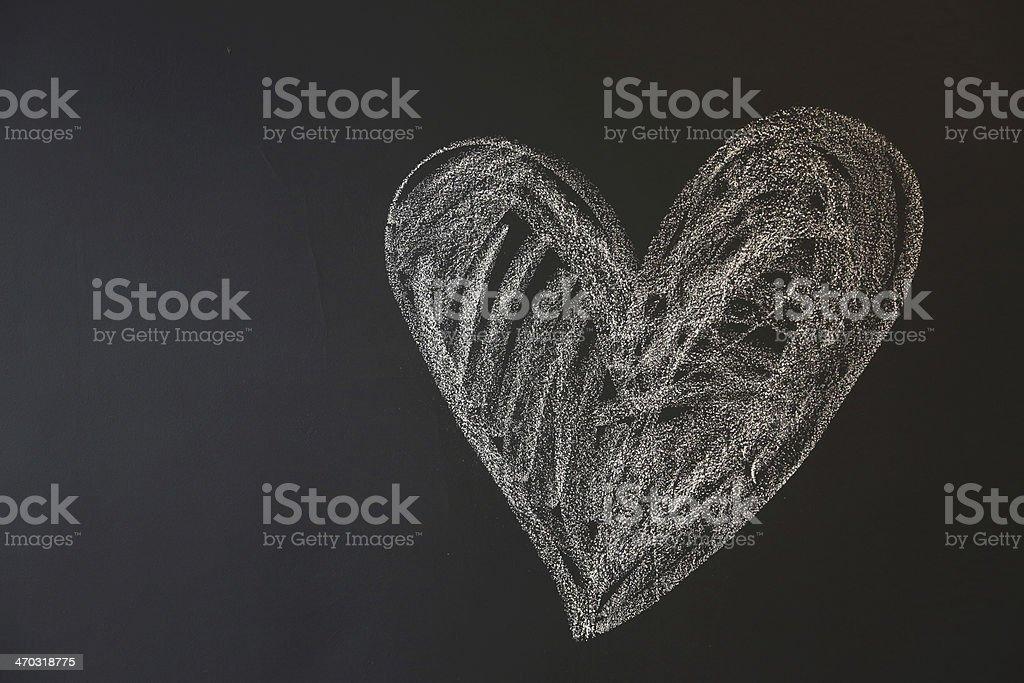 Chalk heart on blackboard royalty-free stock photo