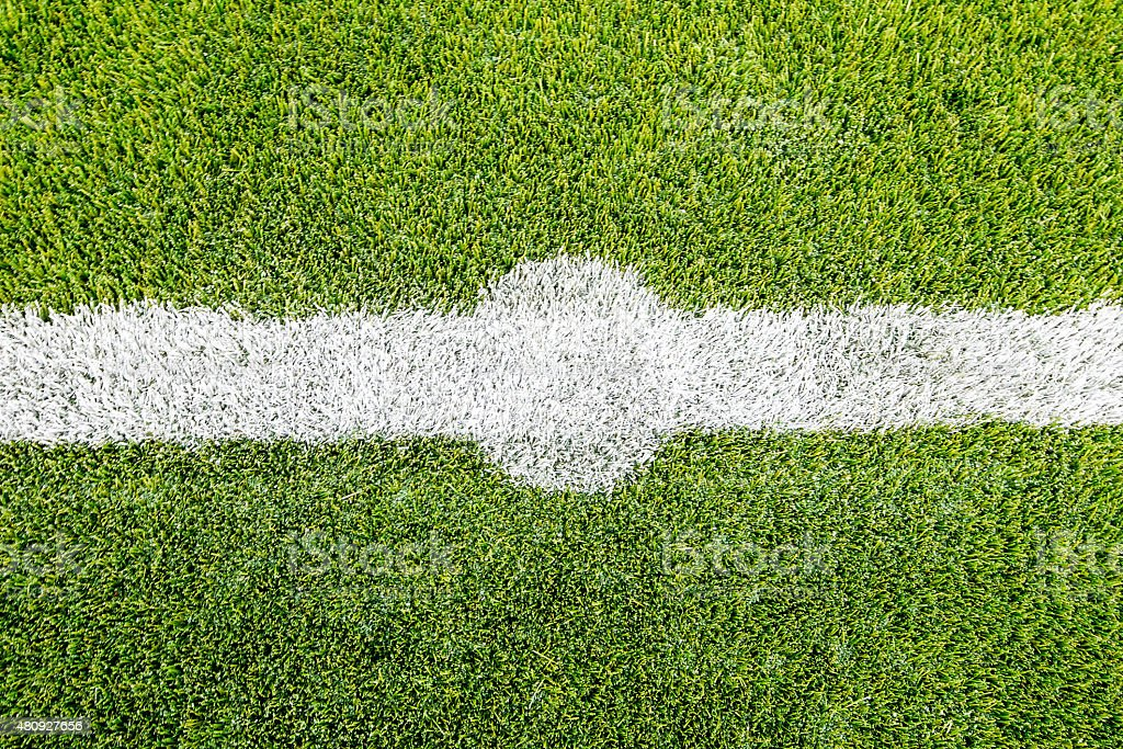 Chalk line on artifical turf soccer or football field stock photo