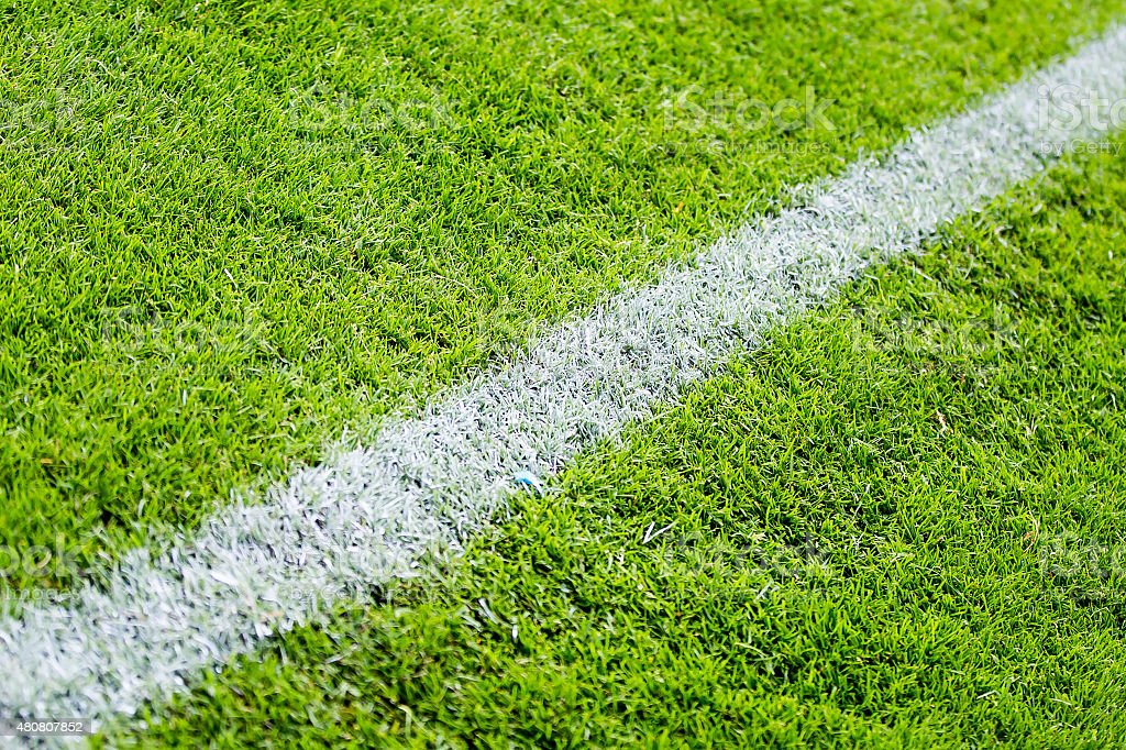 Chalk line on the football or soccer field stock photo