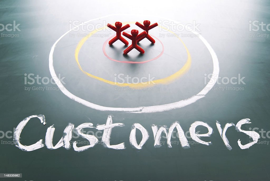 Chalk target with figures representing customers in center stock photo