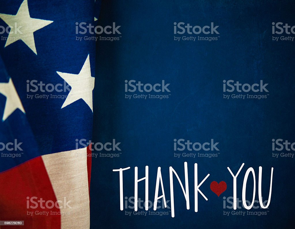 Chalkboard and flag with thank you message for US Veterans stock photo
