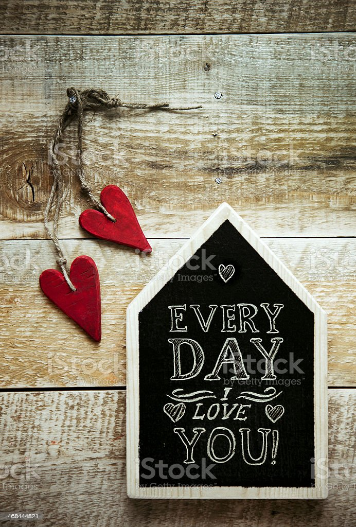 chalkboard  love you with  handmade vintage hearts over wooden background stock photo