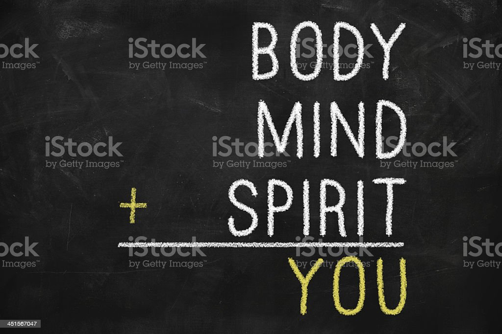 Chalkboard math problem says body mind and spirit equal you stock photo