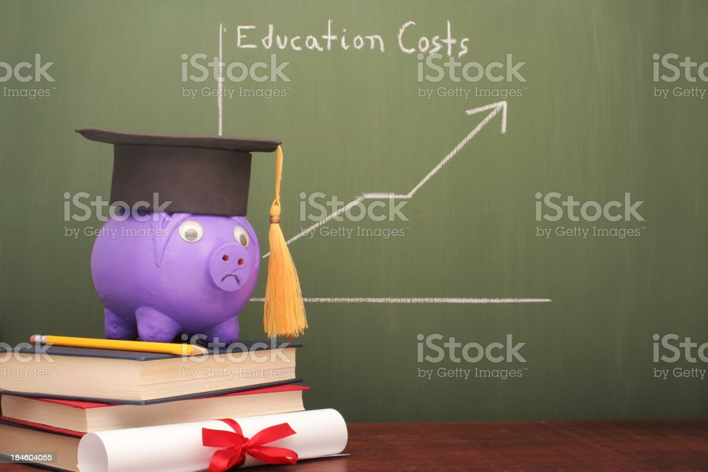 Chalkboard showing education costs graph with a piggy bank stock photo