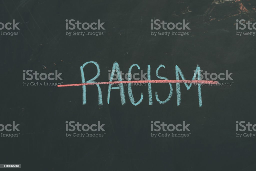 Chalkboard sign letters 'Racism' stock photo