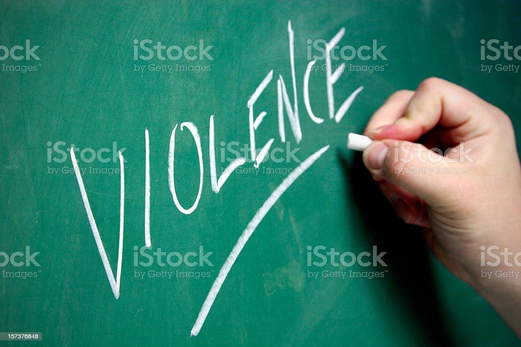 Chalkboard - Violence stock photo