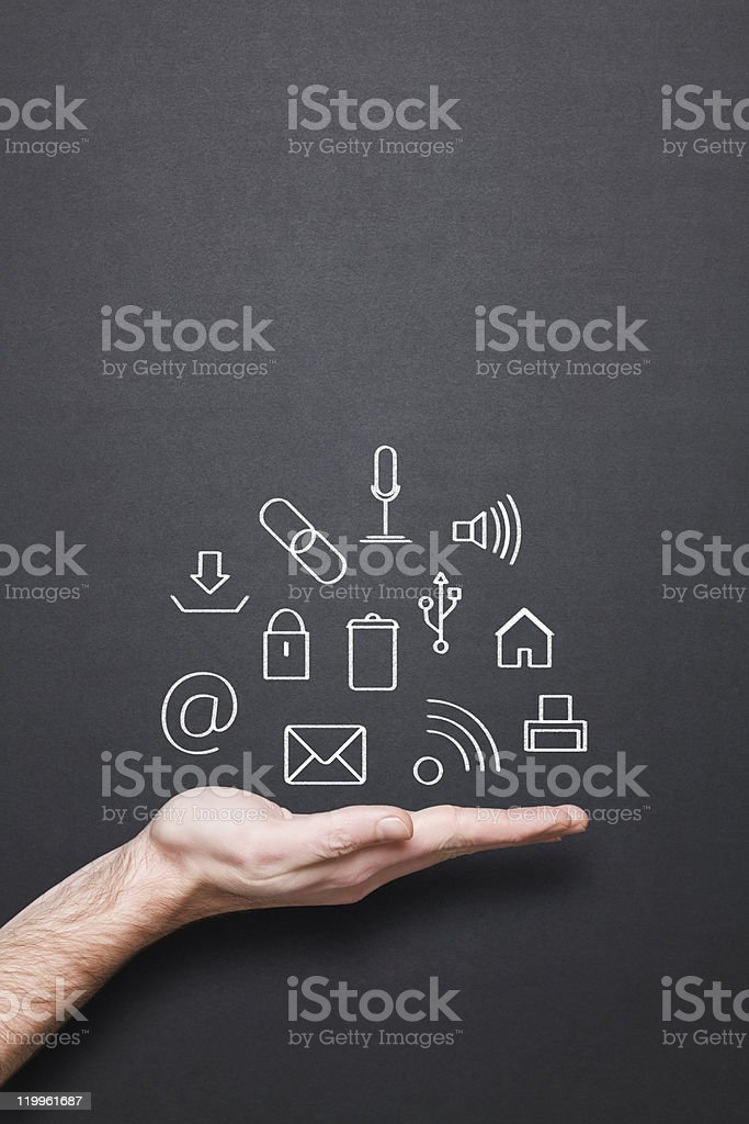 chalkboard with hand and computer related drawing royalty-free stock photo
