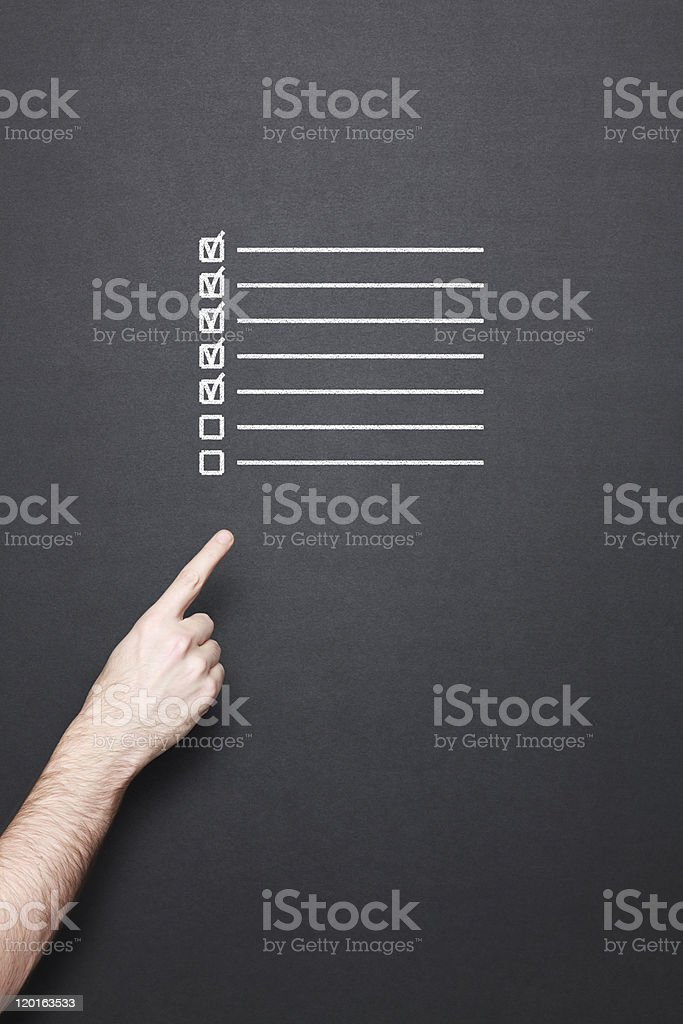 chalkboard with hand and to do list royalty-free stock photo
